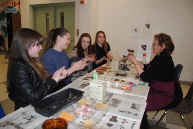 Training WVHS volunteer pottery assistants