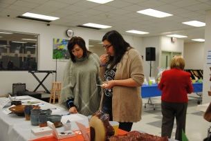Admiring the Silent Auction items