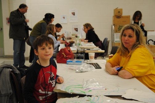 Lion's Club volunteer at Kids' Activity Table