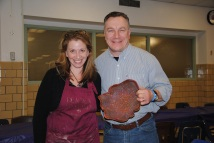 Potter Roberta Green with raffle winner of her ceramic piece