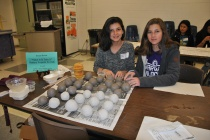 WVHS Empty Bowls Club members prepare clay balls for kids' pottery projects.