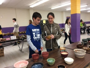 Empty Bowls attendees look over some of the beautiful bowls for sale at the fundraiser event.