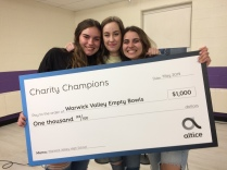"""WVHS Empty Bowls Club Members proudly display their $1000 award from Altice's """"Charity Champions"""" program."""