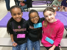 Young attendees sporting their kids passes and face painting.